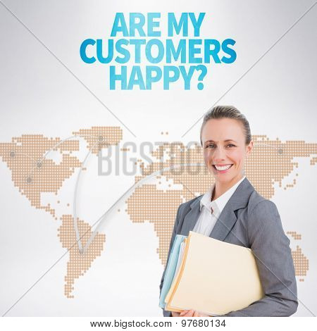 Smiling businesswoman against world map with lines