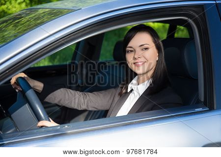 Young Business Woman Driving Her Car