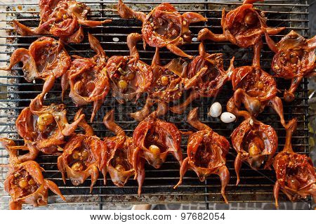 Grilled Small Asian Birds In Spicy Marinade