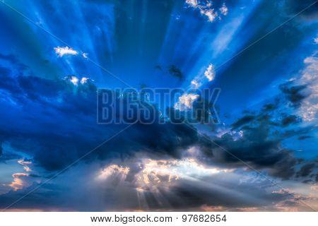 Sun Beams Shine Through Clouds