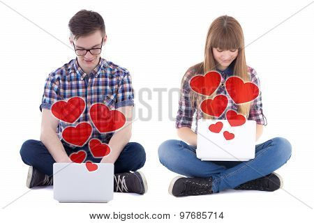 Online Dating Concept - Teenage Boy And Girl Sitting With Computers Isolated On White