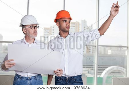 Cheerful builders are planning to build a new construction