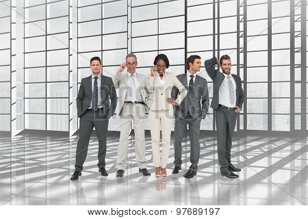 Business team against room with large window overlooking city