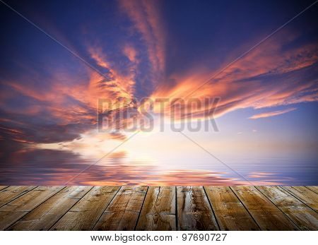 Empty Wooden Deck Table With Dusk Sky Background