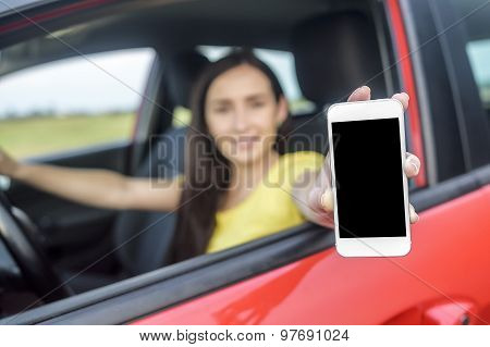 Driver woman showing her smartphone.