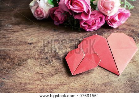 Heart Shape With Pink Rose Flower On Wooden Table, Vintage Tone