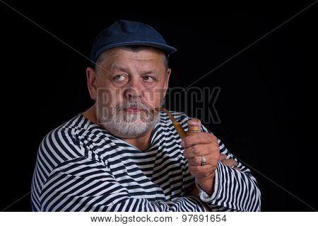 Portrait of senior sailor with tobacco-pipe