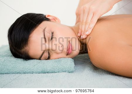 Beautiful brunette on a massage table at spa center