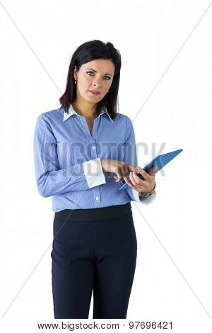 Businesswoman using her tablet pc on white background