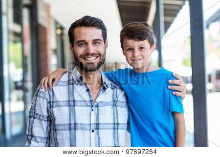 Portrait of a son and a father at the mall