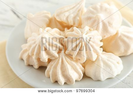 French and tasty Meringue on wooden table
