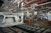 foto of assembly line  - Automotive industry manufacture line with different metal parts - JPG