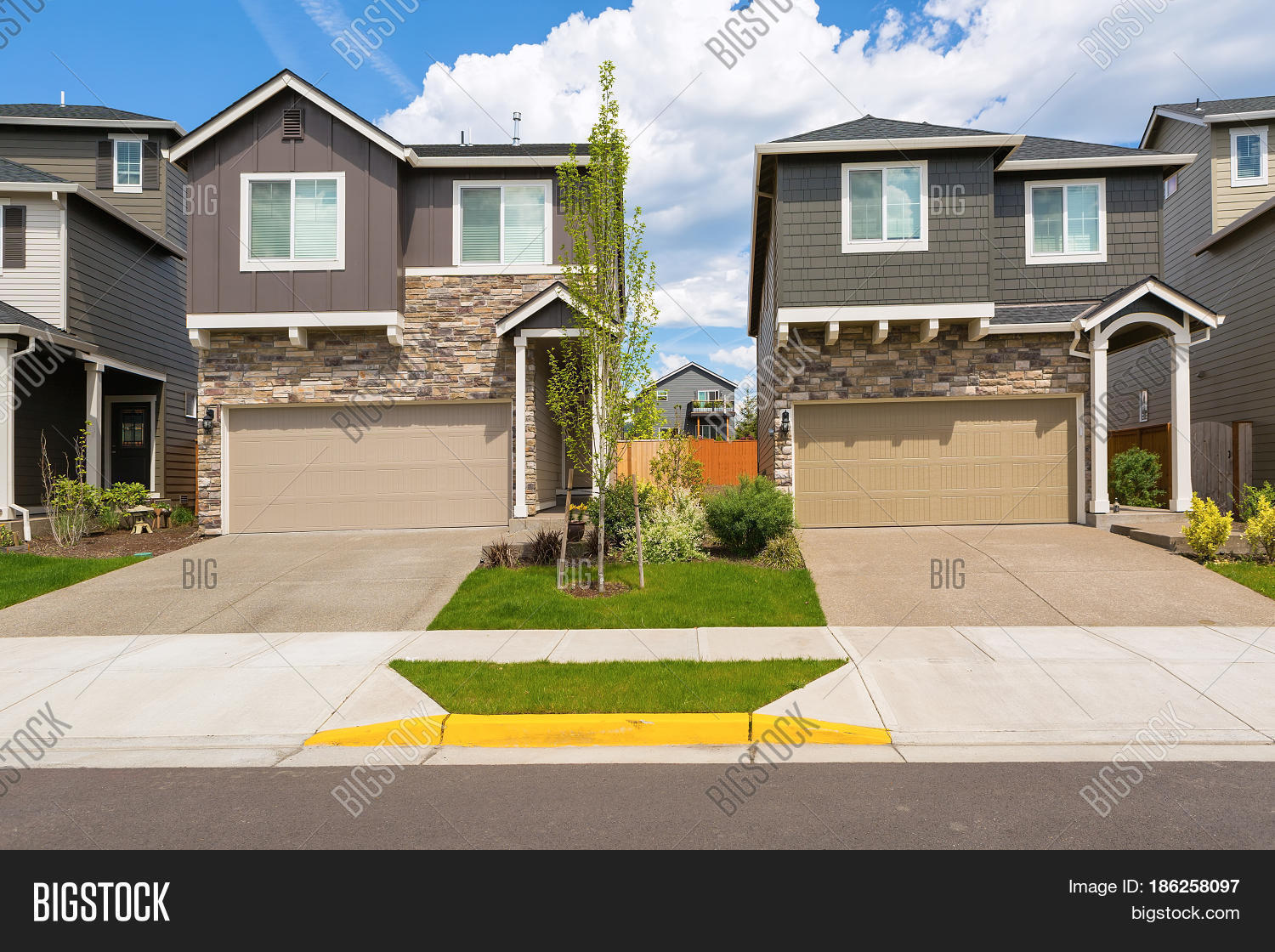 Tract homes front new subdivision image photo bigstock for Tract home builders