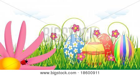 Easter eggs and pink flower in the grass under clouds