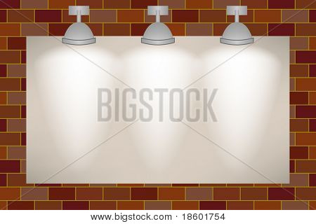 Ad space on the brick wall illuminated with three spotlights