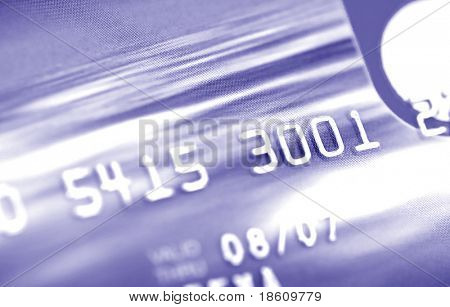 Credit card digits. Macro, shallow DOF (blue tone)