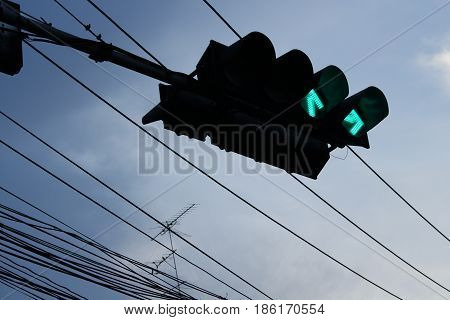 Green on traffic light in the evening