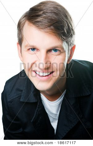 Portrait of nice smiling young man with blue eyes