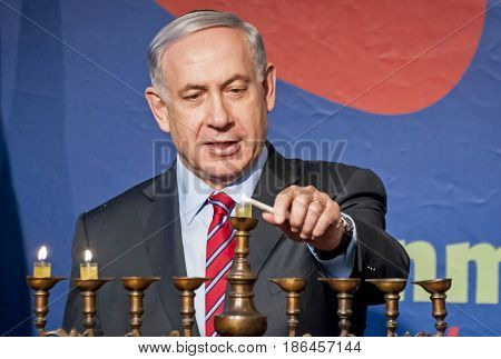 JERUSALEM, ISRAEL -  December 17, 2014. Prime Minister of Israel Benjamin Netanyahu lighting a Hanukkah candle. Stock image.