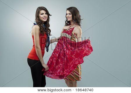 Happy Two Women Trying Red Flower Dress