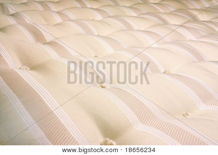 mattress for a bed close up of hand tufted buttons