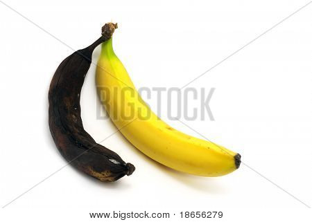 Rotten and fresh bananas. Conceptual image.