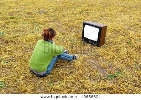Girl watch TV on the yellow meadow. Element of design