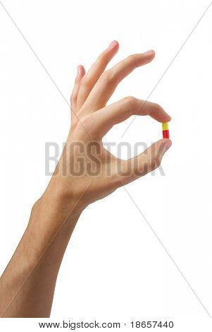 Hand with pill. Element of medical design.