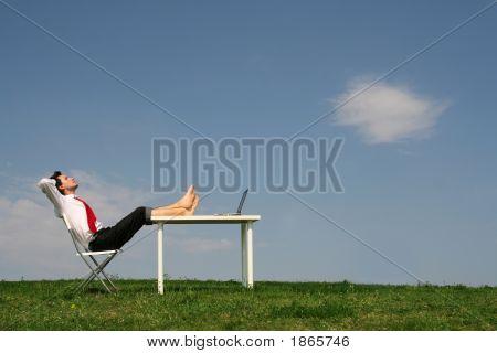 Businessman Sitting At Desk, Outdoors