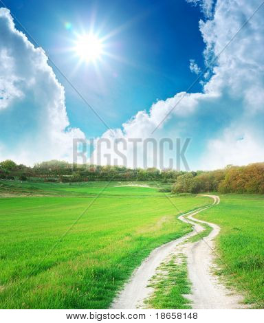Lane in meadow and deep blue sky. Nature design.