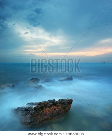 Rocks and sea storm. Dramatic scene. Composition of nature