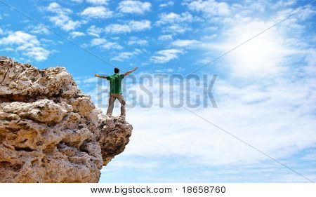 Man on the edge of cliff. Emotional scene.