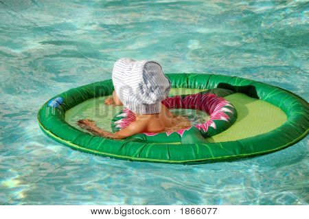 Baby In A Pool Float