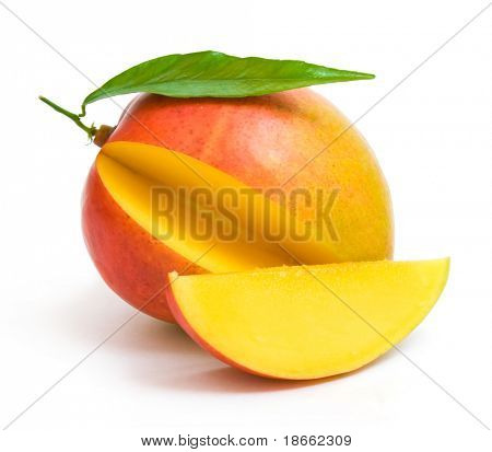 mango with a leaf and a slice