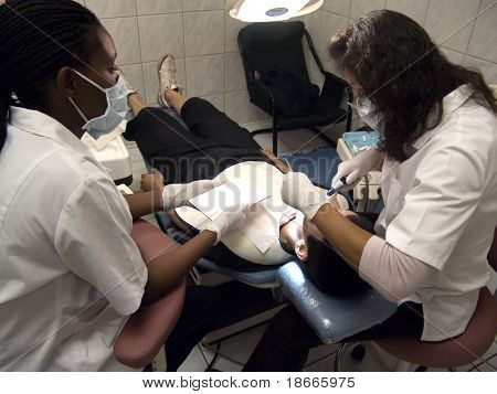 Teenager boy having his cavities fixed by a dentist,