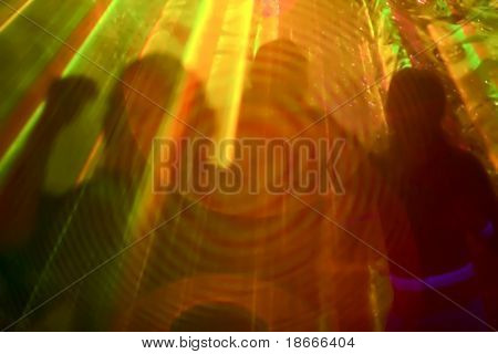 Dancers silhouette, curtain of rainbow light