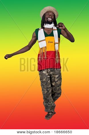 Isolated smiling rastafarian man, clipping path, background the rastafari flag, people diversity series