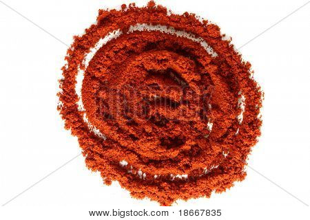 a pile of ground paprika on white, bright red color, sharp shot.