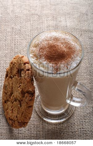 Cafe Coffee - Latte Cappuccino in a tall glass with pecan nut and toffee cookies