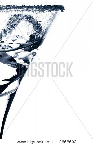 martini glass silhouette with ice cubes, sugar crystal and some drink, with blue reflections, white background and banner space