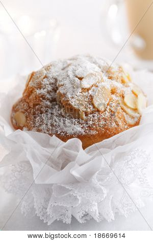 pompous  almond muffin and coffee on background, shallow DOF