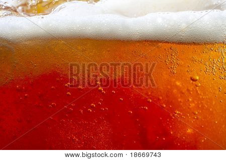 pouring beer with bubbles and froth. super large background