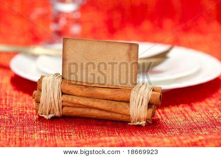 aromatic christmas place setting place  with card, white plate, shallow dof