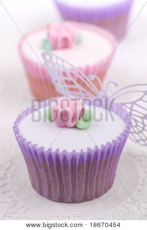 festve cupcakes with sugar flowers , shallow dof