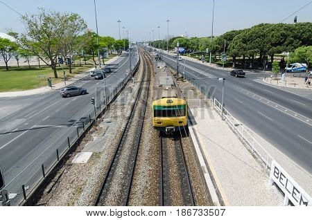 LISBON, PORTUGAL - APRIL 24: Railroad with a train at Avenida da India in the district Belem in Lisbon Portugal on April 24, 2017