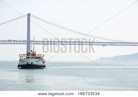 LISBON, PORTUGAL - APRIL 24: The passenger ship Eborense at the Tejo river in Lisbon Portugal on April 24, 2017