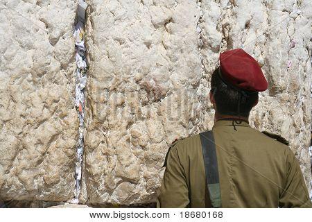 Israeli soldier prays at the Wailing Wall. Jerusalem, Israel