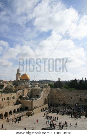 View of the Temple Mount in Jerusalem, including the Western Wall and the golden Dome of the Rock in the Early Morning Sun