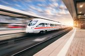 White Modern High Speed Train In Motion poster