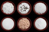 stock photo of sea salt  - six terracotta plates with different salt  - JPG